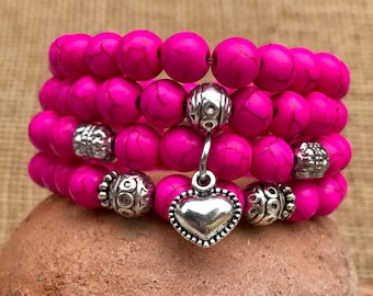 Pink boho stacker set of 4 stretch yoga bracelets. Bright pink turquoise beads with tibetan silver spacer beads and puff heart charm