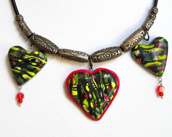 Three hearts necklace strung with recycled silver beads