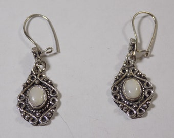Beautiful sterling silver earrings with white stone