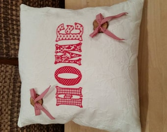 """""""HOME"""" pillow in red"""
