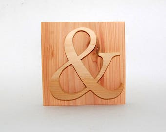 Ampersand sign made from cedar treehouse scraps
