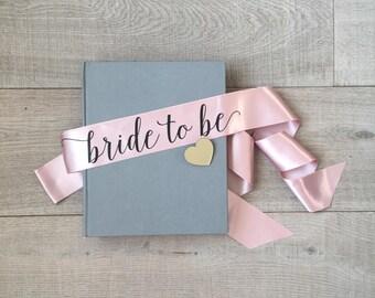 Bride to be sash, bachelorette sash, pale pink and black sash, bachelorette sash with gold mirror heart pin, hen sash, hens party sash