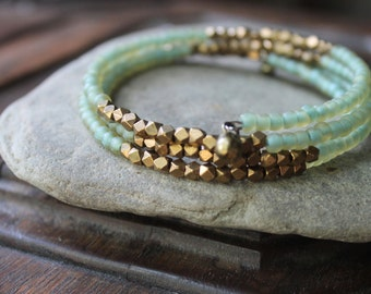 Kalimantan Stacking Memory Wire Bangle Bracelet with Matte Aqua Glass and Faceted Brass Beads - Exotic and Chic
