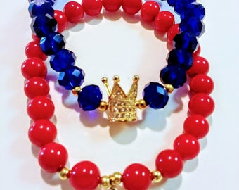 crown and puzzle gold bracelets