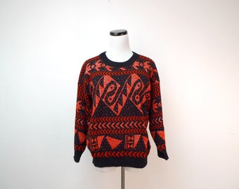 GLAM KNIT . vintage black and red sweater . fits a medium to large . made in USA