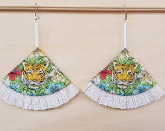 Eye of the tiger large fan earrings with cotton fringe.
