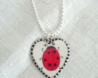 Lovely Ladybug Heart Pendant. Lovingly handmade in Brooklyn by Wishing Well Studio.