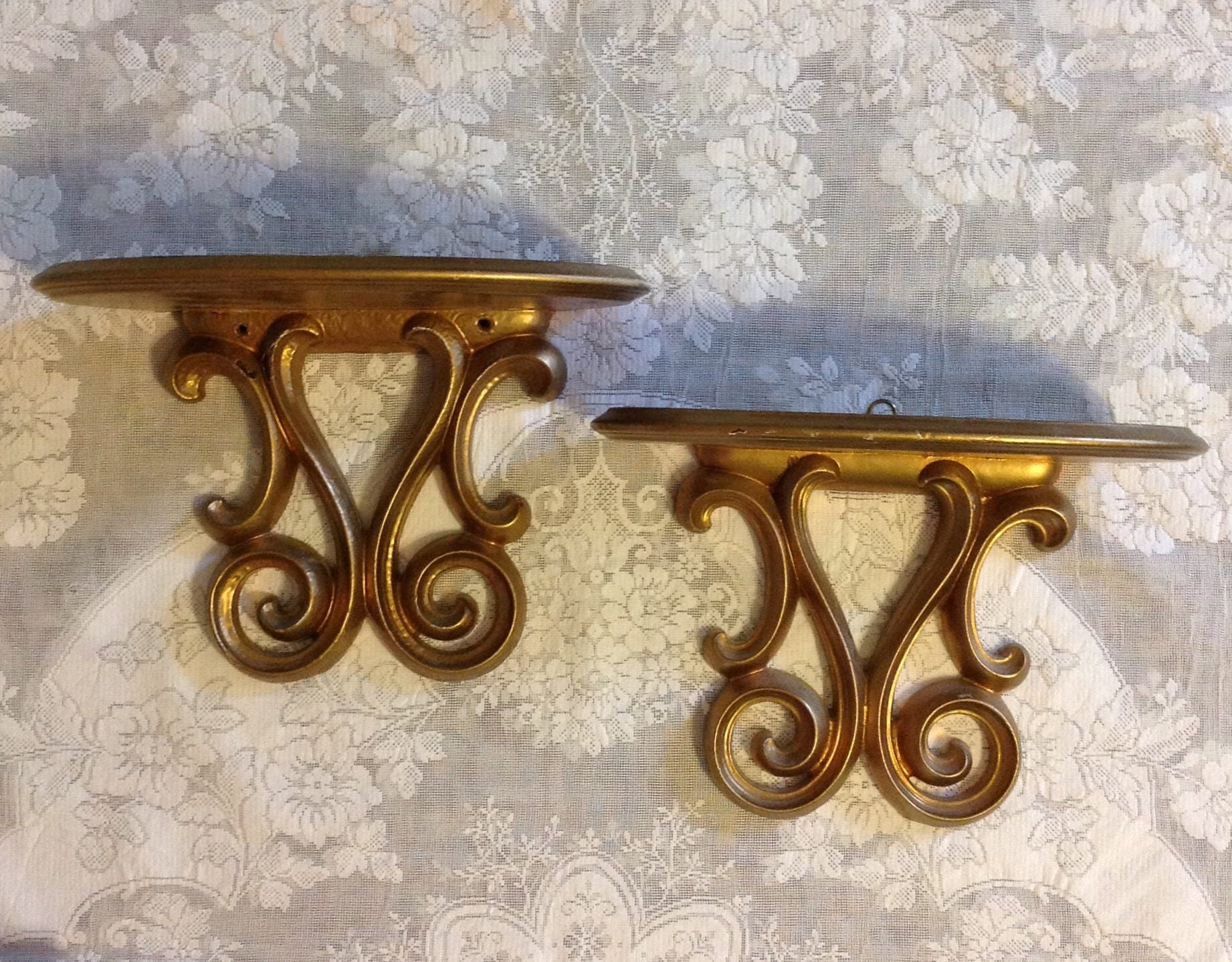 Pair wall sconce shelves ornate gold wood wooden shelf plate