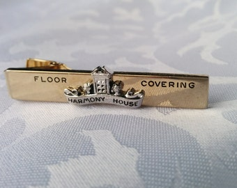 Tie Clip Marked Anson - Harmony House Floor Covering - Gold and Silver Tone