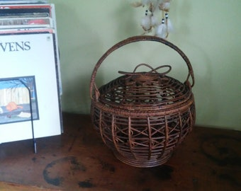 Large intricate brown basket with lid