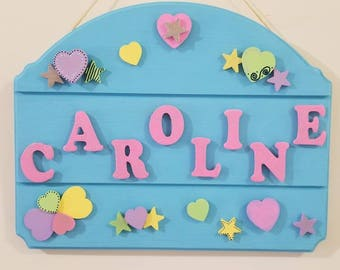 Bright & fun name sign with hearts and stars.