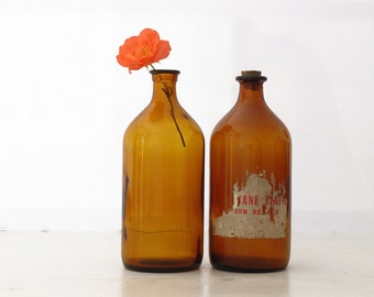 1 large vintage bottle of French pharmacy - amber apothecary jar- with antique label