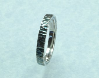 Hammered stacking ring with patina.