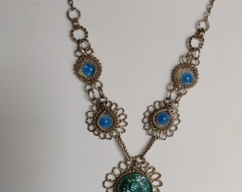 """1960's, 18"""" long necklace of silver tone wire worked lace filigree frames"""