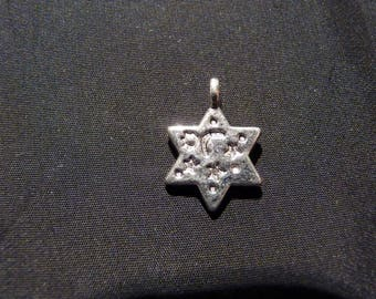 Decorated silver metal star charm