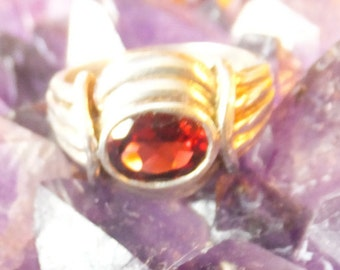 Garnet and Sterling Silver Ring..... size 7 only