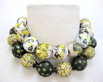 Double strand hand painted wood bead necklace-large wood beads-yellows,blacks,whites.Various painted patterns on beads. Small necklace 17""