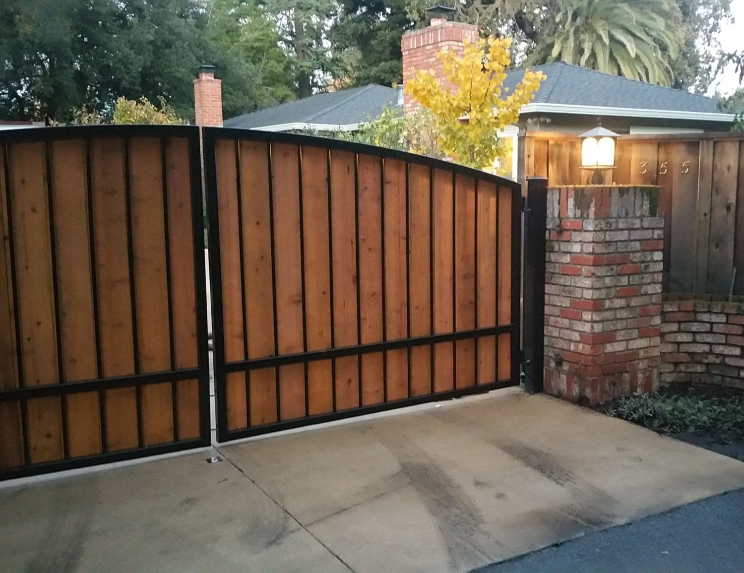Free shipping custom automatic wrought iron redwood swing for Driveway gates online