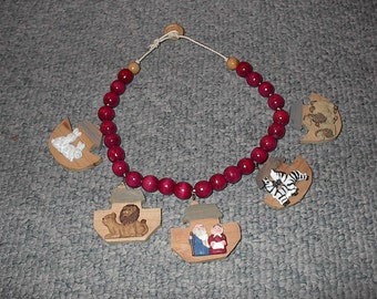 Wood Bead Necklace With Noah And The Animals With A Button Clasp