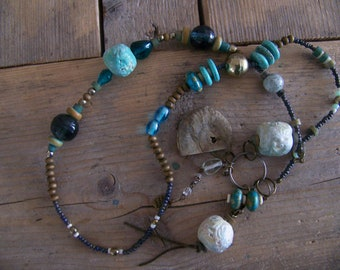 Beautiful primitive ornament, with an ammonite fossil and turquoise natural beads, with a healing energy
