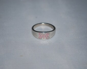 Sterling silver ring size 7.25 with butterfly emblem.