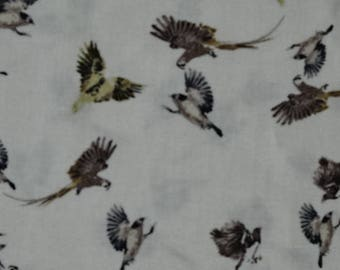 Beige with white birds printed viscose fabric