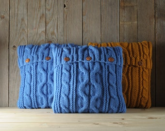 Blue color cable knit pillow cover with 3 wooden buttons.