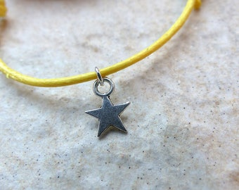 Star bracelet with sliding knots cords either leather or waxed thread lucky charm