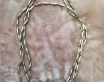 Three strands of Silver beads