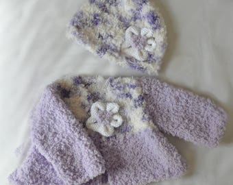 Snuggly, hand knitted baby cardigan with matching hat and flower trim. Baby knits. Baby gift, baby shower