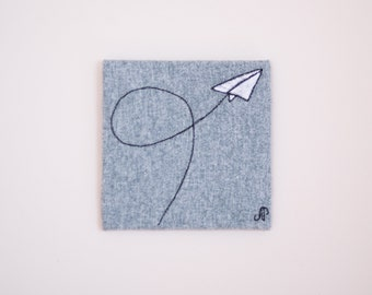 paper plane - drawing with thread on tiny canvas
