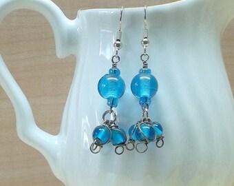 blue triple beaded earrings,blue glass beaded earrings,blue beaded earrings,blue glass bead earrings,blue earrings,