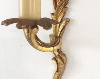 Applique in golden bronze
