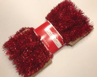 15 feet of red tinsel garland, (MBR)