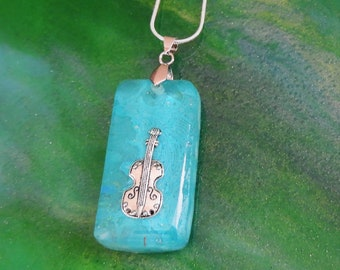 Sterling silver chain, resin, turquoise pigments, violin