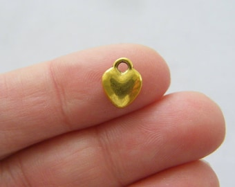 14 Heart charms antique gold tone GC261
