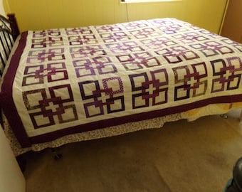 Hand quilted full size bed quilt