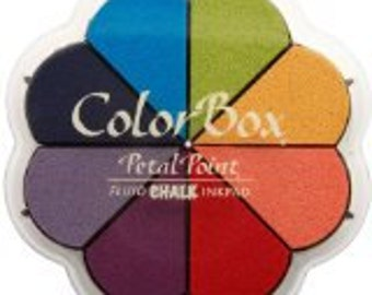 ColorBox pigment pads are water based and formulated to stamp on absorbent papers