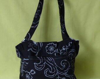 bag items, costume, black floral gray handles to shoulder