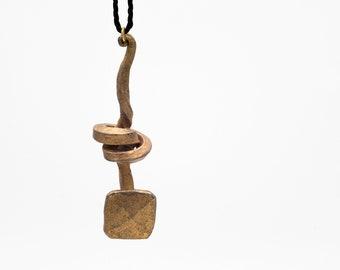 Blacksmiths knotted nail pendant
