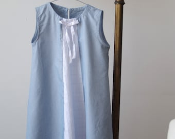 Sleeveless blue cotton girl's dress