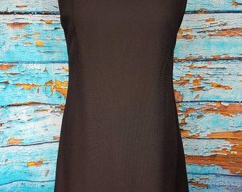 60s black ruffled dress, very Audrey hepburn.