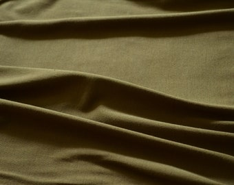 Organic Telio Bamboo Knit in Olive color.  Jersey knit fabric 95% Organic Bamboo w/ great drape for dresses and tops. Purchase by 1/2 meter
