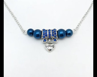 """Love"" necklace and blue glass beads"