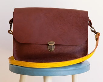 Brown shoulder bag, yellow shoulder strap