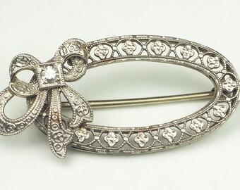 Precious antique 14k white gold oval bow pin