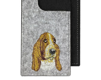 Basset - A felt phone case with an embroidered image of a dog.