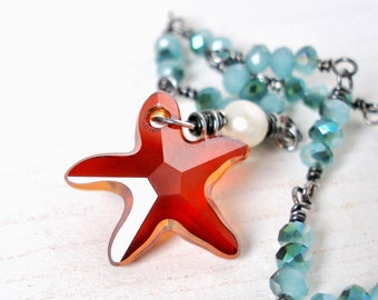 ON SALE Red Magma Starfish Necklace Sterling Wrapped Oxidized Sterling Silver with A Freshwater Pearl and Blue Crystal Swarovski Starfish