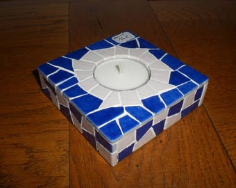 The square blue and white mosaic candle holder