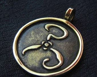 "Brass ""Yellow Sign"" pendant"
